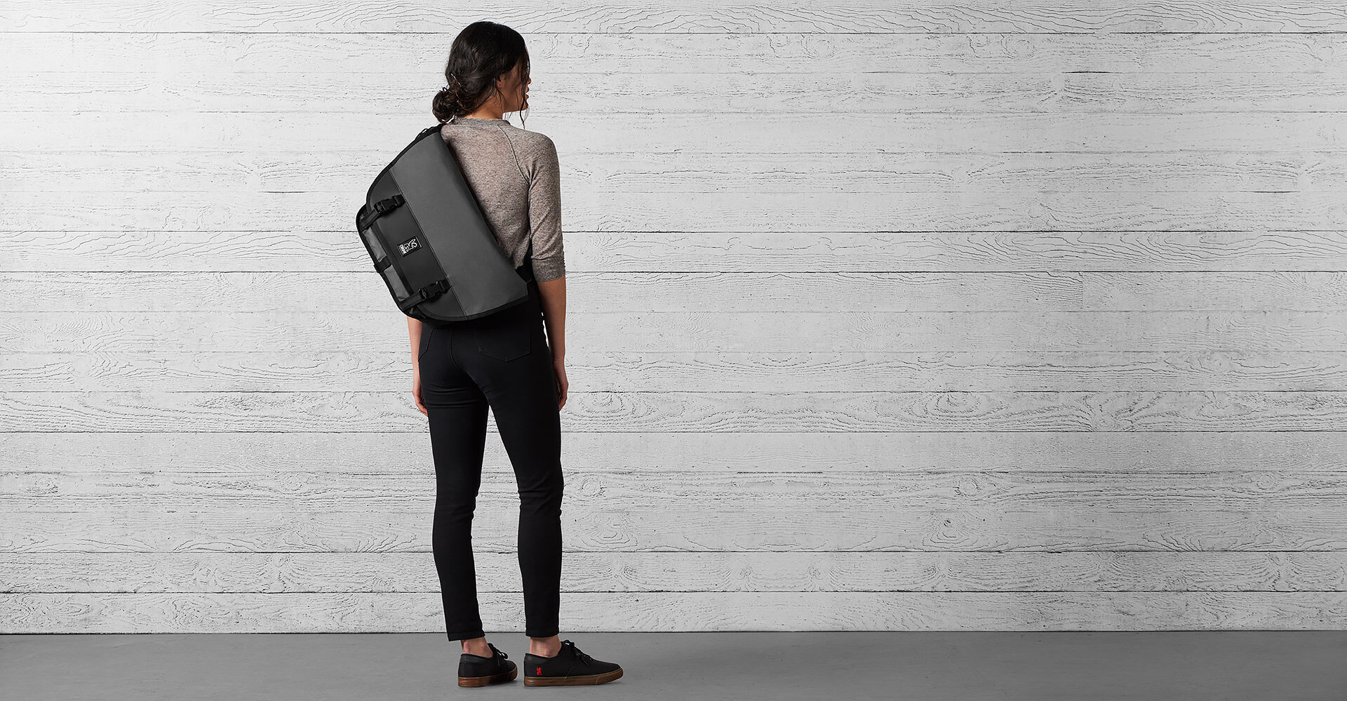 The Welterweight Mini Metro Messenger Bag in Charcoal / Black - wide view.