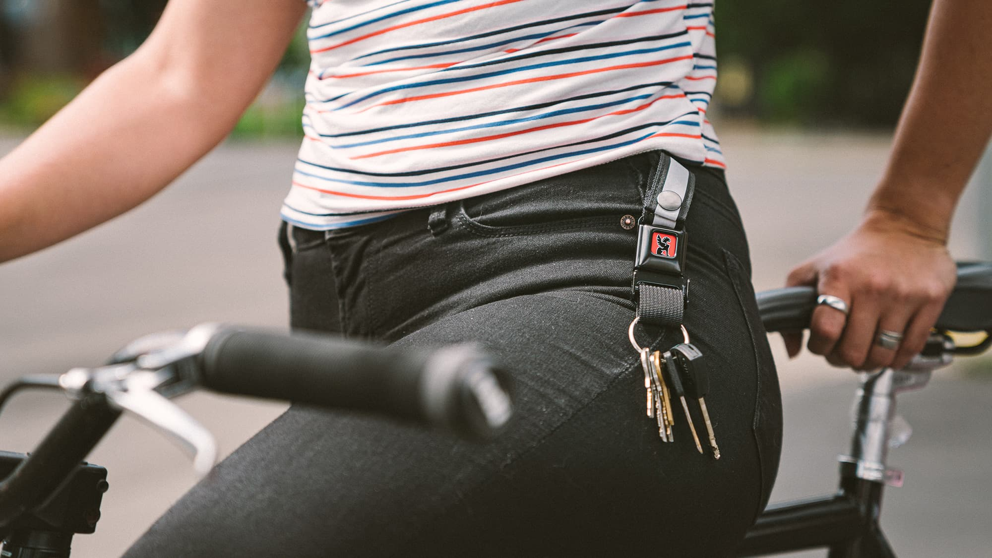 keychain connected to women's belt