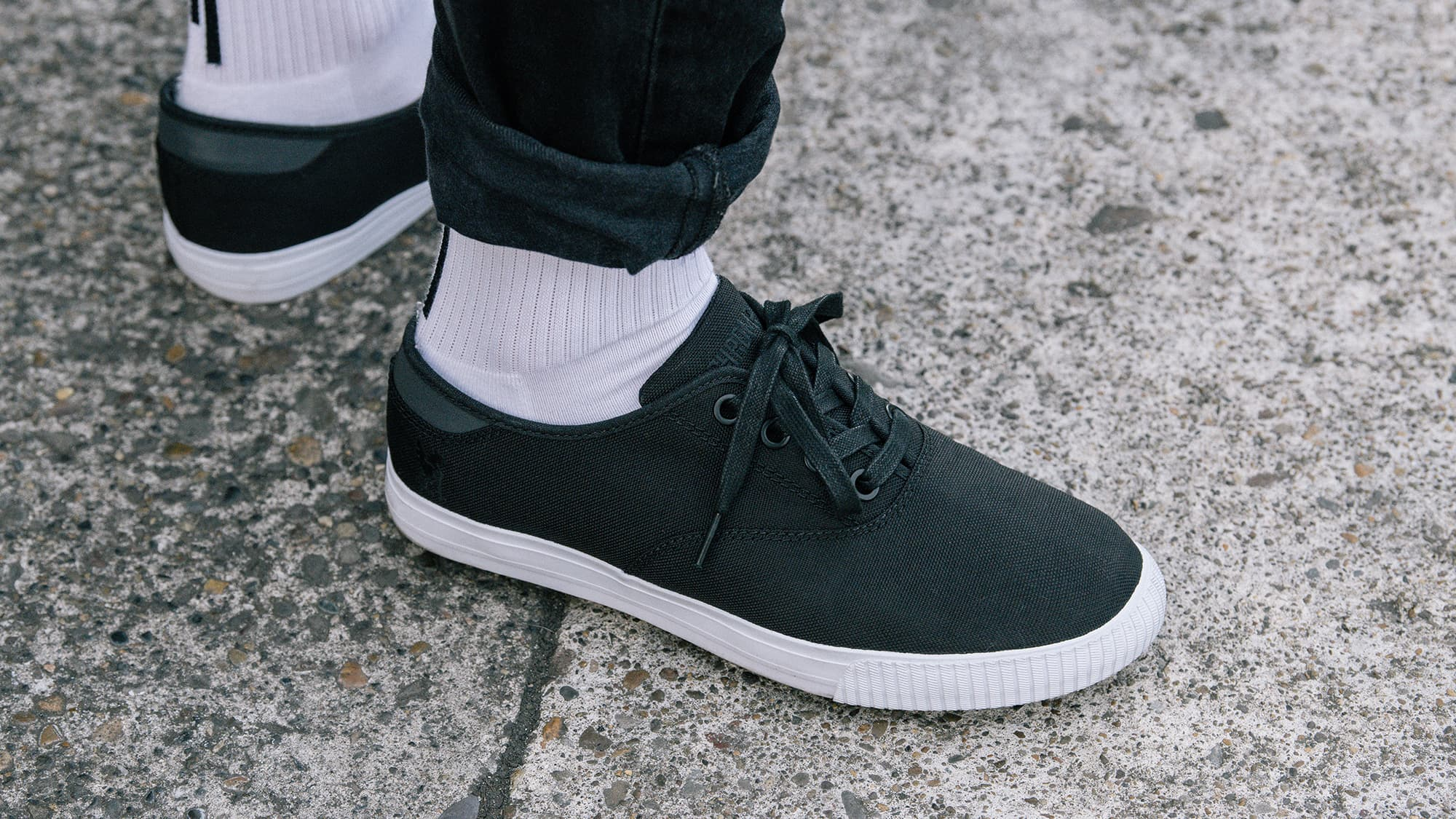 Truk sneakers worn with white socks in style